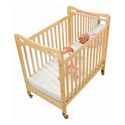 Safe & Sound™ Fixed Side Mirror Compact Crib